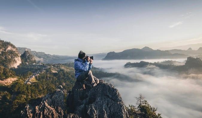 a man taking photos on a mountain