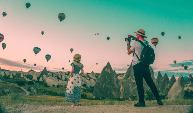 a man and woman with hot air balloons